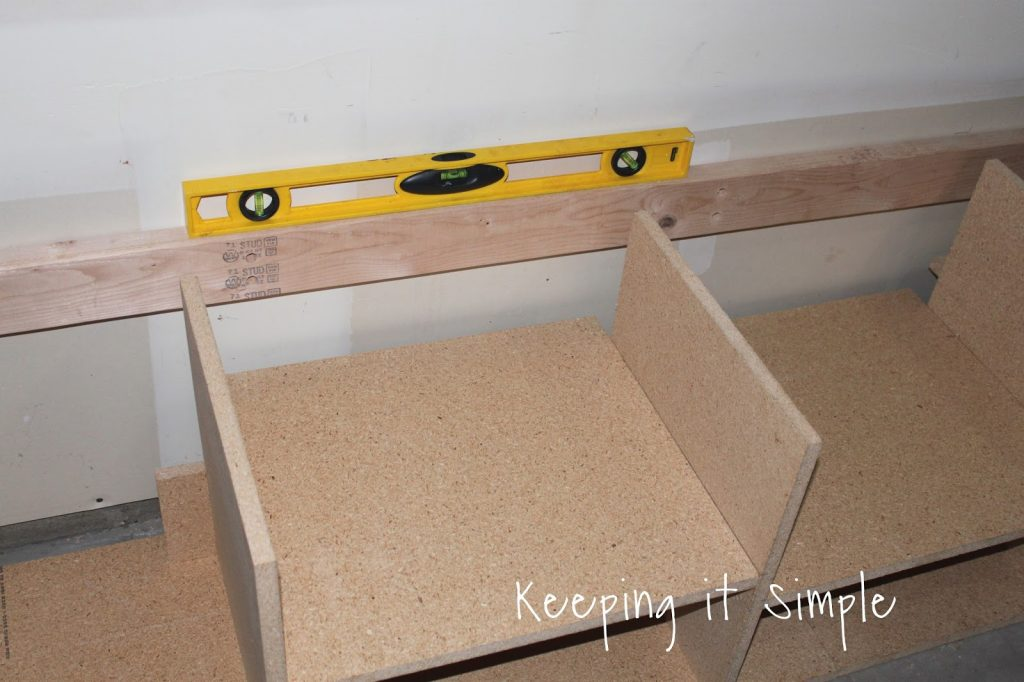 Diy garage mudroom lockers with lots of storage keeping it make sure to line the top of the 24 to the stop of the shelf walls the 24 is there to support the bench and to have it hooked into the wall solutioingenieria Choice Image