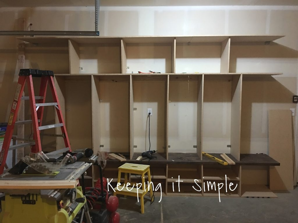 Diy garage mudroom lockers with lots of storage keeping it now its time for the sides we wanted the sides to be a solid piece so we cut it 18 by just under 8 feet we nailed it into the other pieces solutioingenieria Choice Image