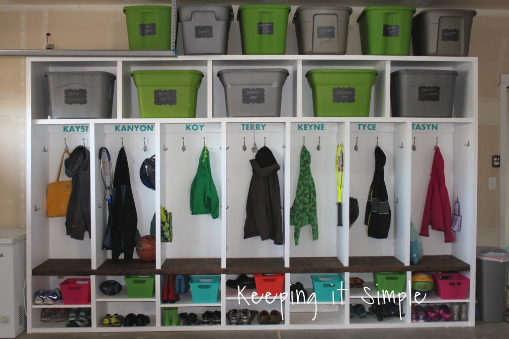 Diy garage mudroom lockers with lots of storage keeping it and finally i added some awesome hooks added our names with vinyl got a few baskets for things and filled it up solutioingenieria Choice Image