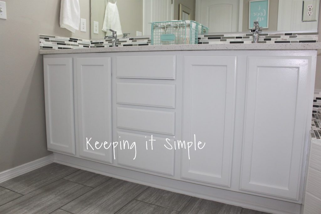 tips on how to paint dark veneer cabinets white with iced white rh keepingitsimplecrafts com how to paint veneer bathroom cabinets how to paint veneer kitchen cabinets