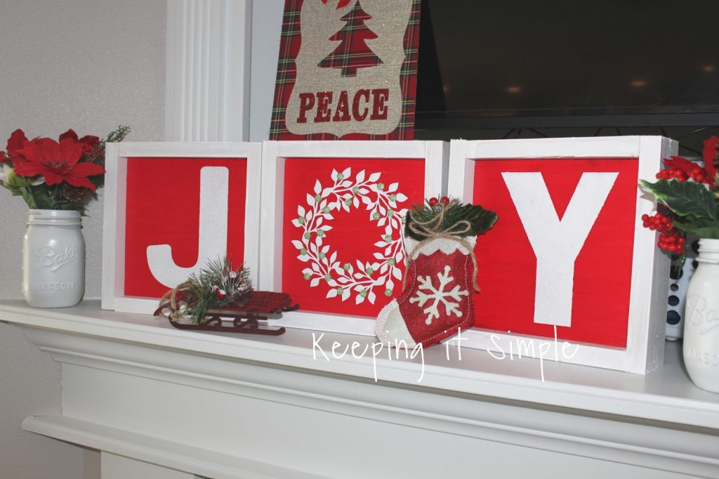 it might be hard to tell but the green berries on the wreath are glittery too because you cant have too much glitter - Diy Christmas Signs